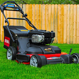 Toro Timemaster walkbehind mower in yard