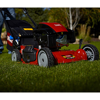 Toro Walkbehind mower being used