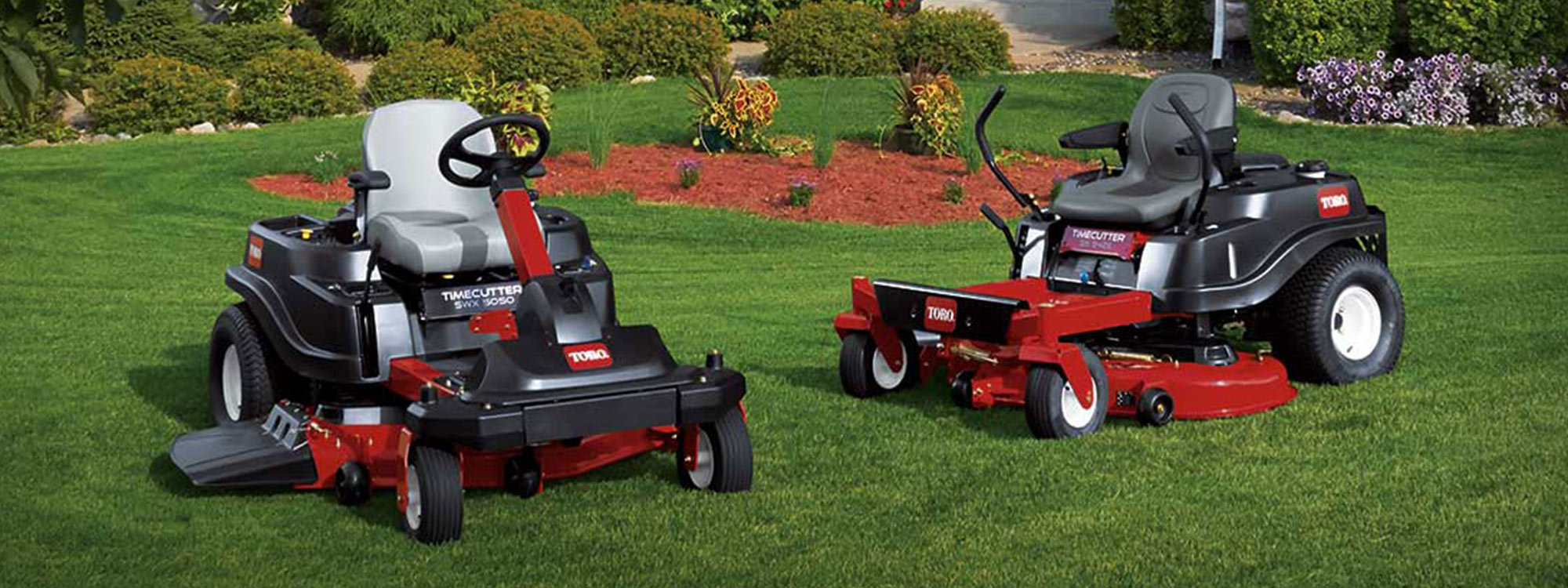 Two Toro timecutter mowers